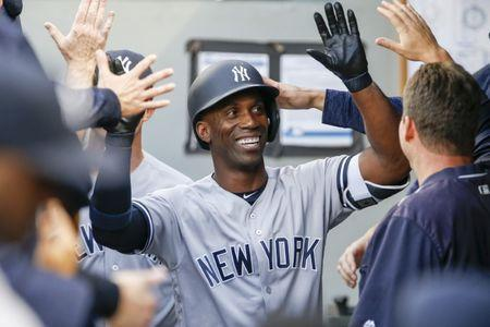 FILE PHOTO: Sep 8, 2018; Seattle, WA, USA; New York Yankees right fielder Andrew McCutchen (26) is greeted in the dugout after hitting his solo home run against the Seattle Mariners during the first inning at Safeco Field. Mandatory Credit: Joe Nicholson-USA TODAY Sports