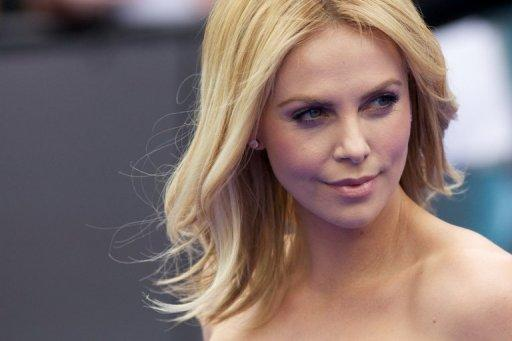 South African actress Charlize Theron arrives on the red carpet to attend the world premiere of the film 'Prometheus' in London on May 31. Rupert Murdoch's embattled media giant News Corp, whose film holding Twentieth Century Fox made 'Prometheus', posted a net loss of $1.51 billion in its fiscal fourth quarter Wednesday, as the firm prepared for a major restructuring