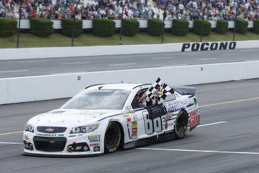 Dale Earnhardt Jr. celebrates after winning the the NASCAR Sprint Cup Series auto race at Pocono Raceway, Sunday, Aug. 3, 2014, in Long Pond, Pa. (AP Photo/Matt Slocum)