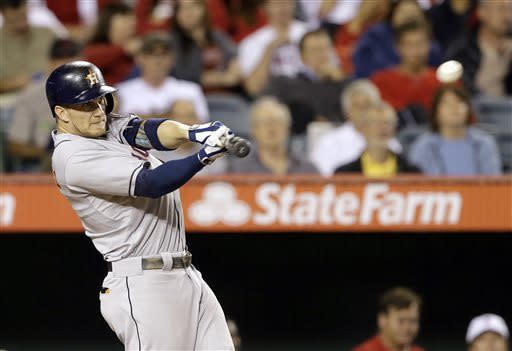 Houston Astros' Brandon Barnes connects on a sacrifice fly to center that scored Matt Dominguez against the Los Angeles Angels in the sixth inning of a baseball game in Anaheim, Calif., Monday, June 3, 2013. (AP Photo/Reed Saxon)