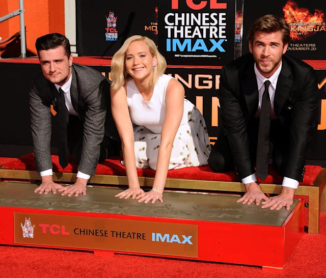 <p>To mark the opening of the fourth and final installment in <i>The Hunger Games </i>series, the star trio is immortalized in cement at the Chinese Theatre in Hollywood on Oct. 31, 2015. (Photo: Getty Images) </p>