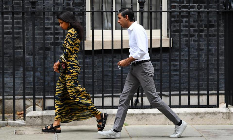 Rishi Sunak, Chancellor of the Exchequer and his wife Akshata Murthy leave No.10 Downing Street. 14 Aug 2020