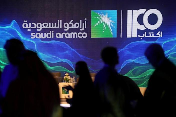 Sign of Saudi Aramco's IPO is seen during a news conference by the state oil company in Dhahran