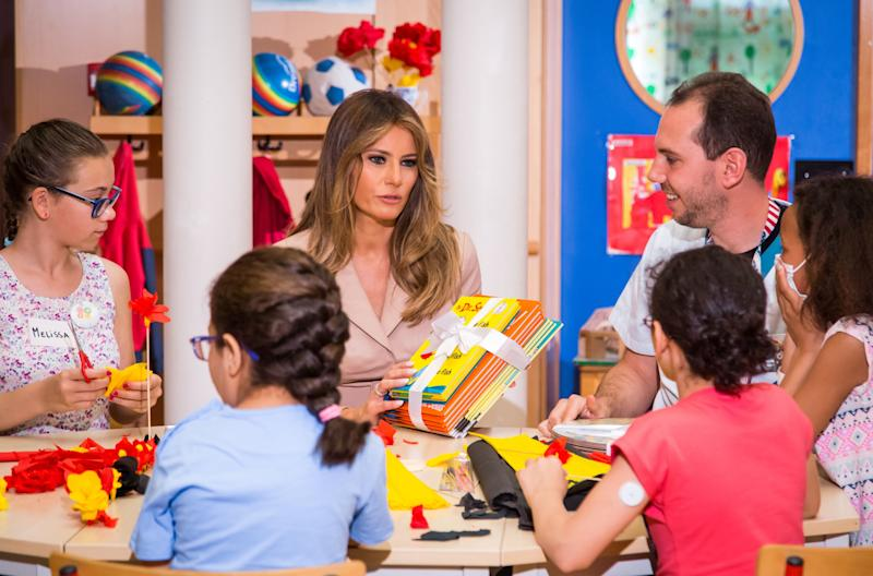Melania Trump gives Dr. Seuss books to patients as she visits the Queen Fabiola Children's Hospital in Brussels in May.