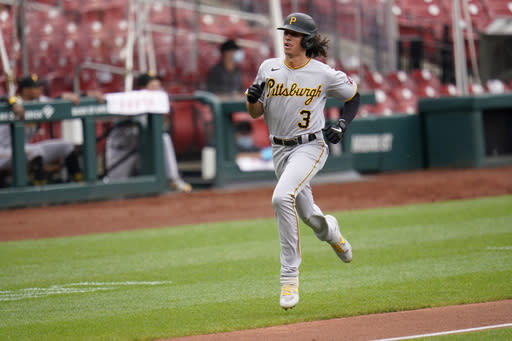 Pittsburgh Pirates' Cole Tucker jogs home to score on a single by Jacob Stallings during the fourth inning in the first game of a baseball doubleheader against the St. Louis Cardinals Thursday, Aug. 27, 2020, in St. Louis. (AP Photo/Jeff Roberson)