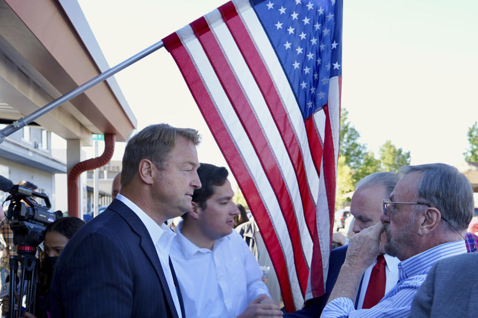Republican Dean Heller speaks to a supporter outside the Carson City Republican Club on Monday, Sept. 20, 2021 in Carson City, Nev. The former U.S. Senator joins a crowded Republican primary field in what's expected to be among the most competitive gubernatorial races in the United States. (AP Photo/Samuel Metz)