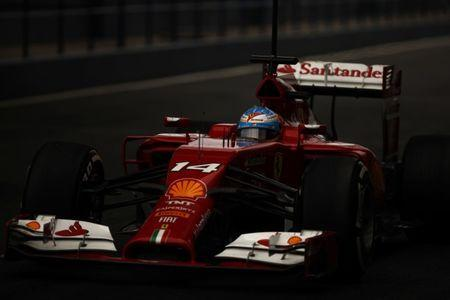 Ferrari Formula One racing driver Fernando Alonso of Spain drives his F14 T in the pit lane during pre-season testing at the Jerez racetrack in southern Spain January 31, 2014. REUTERS/Jon Nazca