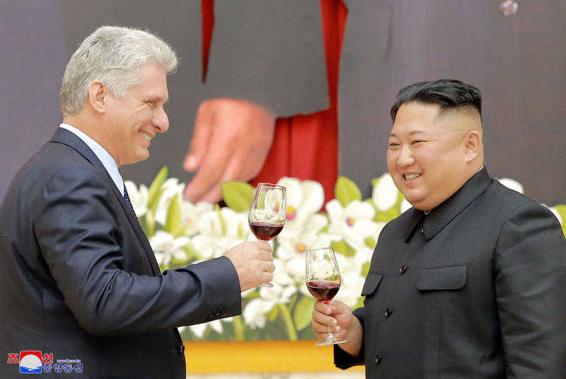 "In this Sunday, Nov. 4, 2018 photo released by the North Korean government, Cuban President Miguel Diaz-Canel, left, and North Korean leader Kim Jong Un raise glasses for a toast during a welcome banquet in Pyongyang, North Korea. Both, hoping to get out from under U.S. economic sanctions, agreed to expand and strengthen their strategic relations, North Korea's state media reported Monday, Nov. 5, 2018. Independent journalists were not given access to cover the event depicted in this image distributed by the North Korean government. The content of this image is as provided and cannot be independently verified. Korean language watermark on image as provided by source reads: ""KCNA"" which is the abbreviation for Korean Central News Agency. (Korean Central News Agency/Korea News Service via AP)"