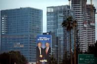 FILE PHOTO: A Likud election campaign billboard, depicting U.S. President Donald Trump shaking hands with Israeli Prime Minister Benjamin Netanyahu, is seen at a main entrance to Tel Aviv, Israel