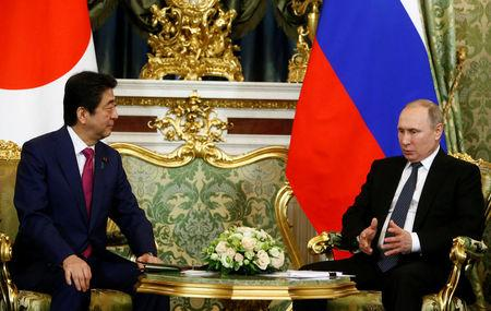 Russian President Vladimir Putin (R) meets with Japanese Prime Minister Shinzo Abe at the Kremlin in Moscow, Russia April 27, 2017. REUTERS/Sergei Karpukhin