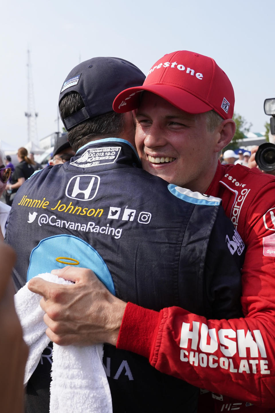 Marcus Ericsson, of Sweden, celebrates with Jimmie Johnson after winning the first race of the IndyCar Detroit Grand Prix auto racing doubleheader on Belle Isle in Detroit, Saturday, June 12, 2021. (AP Photo/Paul Sancya)