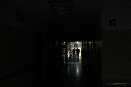 People walk in the corridors of the Central Hospital of San Cristobal during a blackout in San Cristobal, Venezuela March 14, 2018. Picture taken March 14, 2018. REUTERS/Carlos Eduardo Ramirez