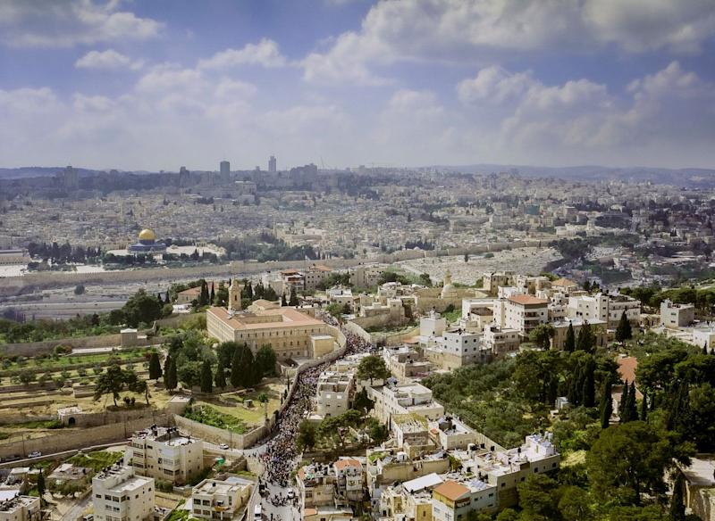 An aerial view of the Palm Sunday procession on the Mount of Olives, an annual event celebrated by Christian pilgrims to commemorate Jesus' entry into Jerusalem a week before his death. (Image exclusive to The Huffington Post)
