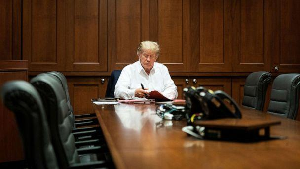 PHOTO: U.S. President Donald Trump works in a conference room while receiving treatment after testing positive for the coronavirus disease (COVID-19) at Walter Reed National Military Medical Center in Bethesda, Maryland, U.S. October 3, 2020. (White House/via Reuters)