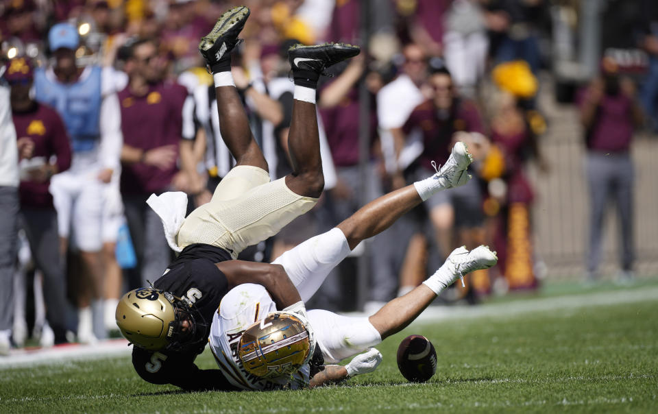 Colorado safety Mark Perry, top, tackles Minnesota wide receiver Chris Autman-Bell after he caught a pass in the second half of an NCAA college football game Saturday, Sept. 18, 2021, in Boulder, Colo. Minnesota won 30-0. (AP Photo/David Zalubowski)