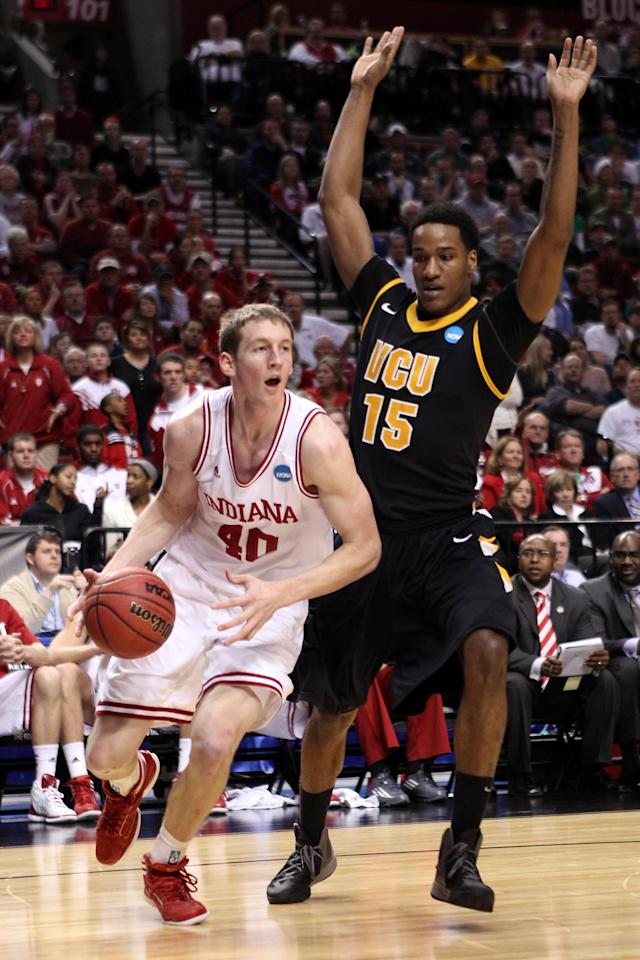 PORTLAND, OR - MARCH 17: Cody Zeller #40 of the Indiana Hoosiers drives on Juvonte Reddic #15 of the Virginia Commonwealth Rams in the second half during the third round of the 2012 NCAA Men's Basketball Tournament at the Rose Garden Arena on March 17, 2012 in Portland, Oregon. (Photo by Jed Jacobsohn/Getty Images)