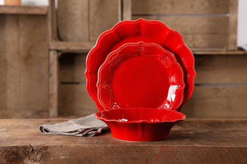 """<p>Scalloped edges and intricate embossed detail make this 12-piece Dinnerware Set a must-have. Available at Walmart, <a href=""""http://yahooshopping.pgpartner.com/plr.php?id=18211"""" rel=""""nofollow noopener"""" target=""""_blank"""" data-ylk=""""slk:$44.92"""" class=""""link rapid-noclick-resp"""">$44.92</a>.<br></p>"""