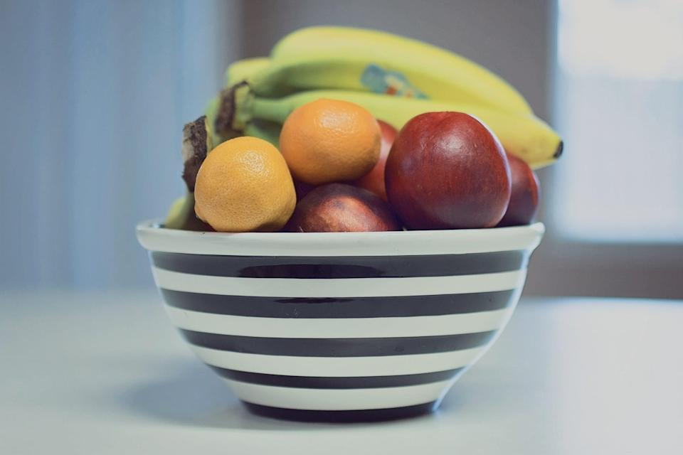 <p>Your fridge space is limited, which means it's time to get some storage for the foods that don't need to be kept in the fridge/freezer. Find a basket or a bowl to keep apples, bananas, oranges, and other whole fruits, and buy storage containers for snacks and canned foods.</p>