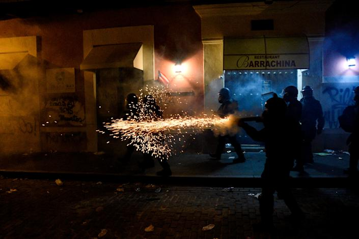 Police fire tear gas at demonstrators during the fifth day of protests calling for the resignation of Governor Ricardo Rossello in San Juan, Puerto Rico July 17, 2019.  (Photo: Gabriella N. Baez/Reuters)