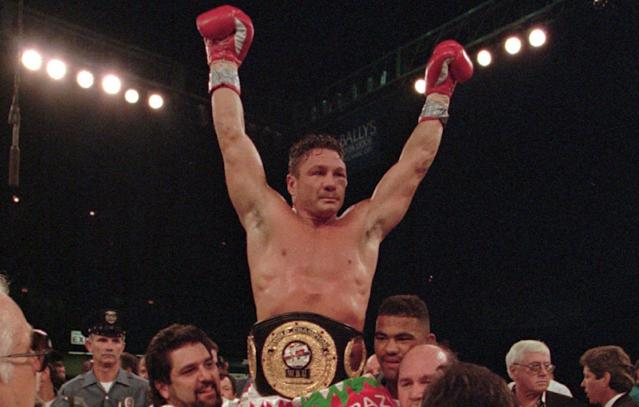 Vinny Pazienza celebrates after defeating Dana Rosenblatt to win the WBU World Super Middleweight title in 1996. (AP)
