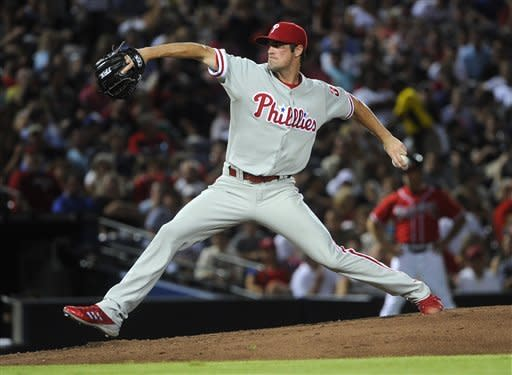 Philadelphia Phillies' Cole Hamels delivers a pitch against the Atlanta Braves during the fifth inning of a baseball game, Friday, July, 27, 2012, in Atlanta. (AP Photo/John Amis)