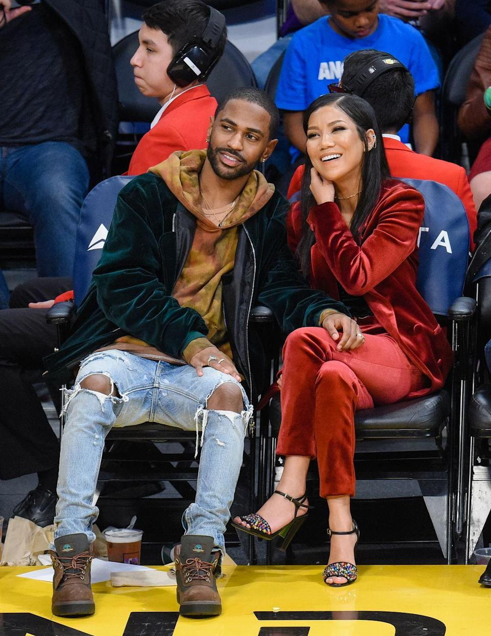 """<p>One look at Big Sean and Jhené's knees, which are angled toward each other, tells Donaldson the couple appreciates any chance they can have to be close to each other. """"The way Big Sean comfortably touches her leg and Jhene does not object signals desire,"""" she says.</p><p>Plus, """"the physical space between them while sitting is minimal to none, and this indicates a high level of happiness and closeness in their relationship,"""" Donaldson adds. Even while their attention is focused on the basketball game, she's confident Jhené and Big Sean have each other on the brain because of the way they're leaning toward each other.</p>"""