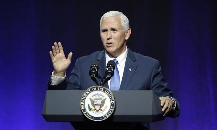 """Vice President Mike Pence waves goodbye as he wraps up an address to a NGA session titled """"Collaborating to Create Tomorrow's Global Economy"""" on the second day of the National Governors Association meeting on July 14, 2017, in Providence, R.I. (Photo: Stephan Savoia/AP)"""