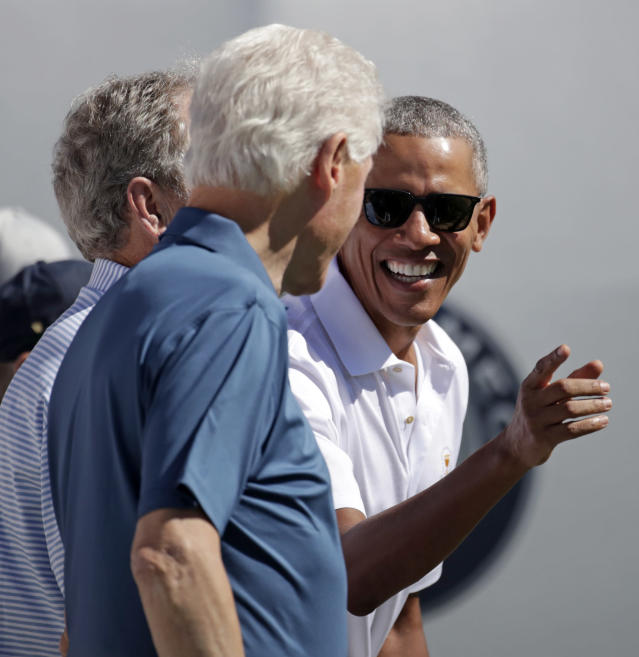 <p>Former President Barack Obama, right, jokes with formers Presidents Bill Clinton, center and George Bush, left, before the first round of the Presidents Cup at Liberty National Golf Club in Jersey City, N.J., Thursday, Sept. 28, 2017. (AP Photo/Julio Cortez) </p>