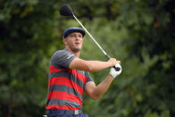 FILE - In this Aug. 29, 2021, file photo, Bryson DeChambeau tees off from the 16th hole during the final round of the BMW Championship golf tournament at Caves Valley Golf Club in Owings Mills, Md. When DeChambeau arrives at Whistling Straits for the Ryder Cup the 6-foot-1, 235-pound disrupter with a world-leading driving average of 323.7 yards, will bring with him an epic amount of baggage. He is in the middle of a months-long feud with one of his teammates, Brooks Koepka, who happens to have three more major titles than DeChambeau. (AP Photo/Nick Wass, File)