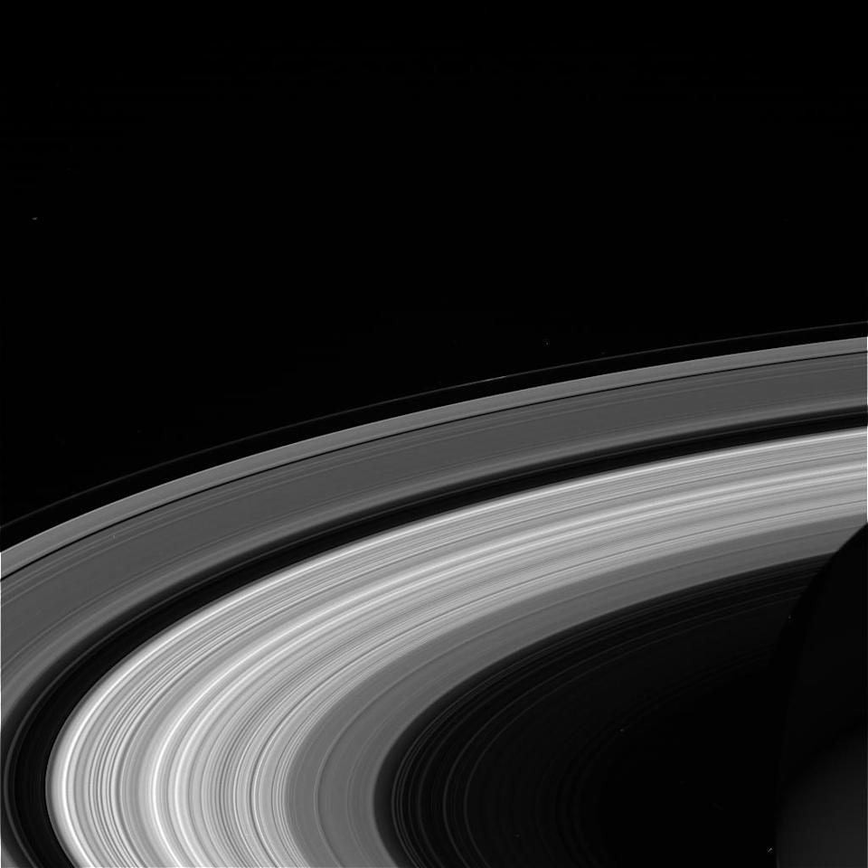 This Wednesday, Sept. 13, 2017 image taken using the CL1 and RED filters and made available Thursday by NASA shows Saturn's rings, as seen from the Cassini spacecraft. NASA's Cassini spacecraft at Saturn is closing in on its fiery finish, following a remarkable journey of 20 years. Cassini is on course to plunge through Saturn's atmosphere and vaporize like a meteor Friday morning. (NASA/JPL-Caltech/Space Science Institute via AP)