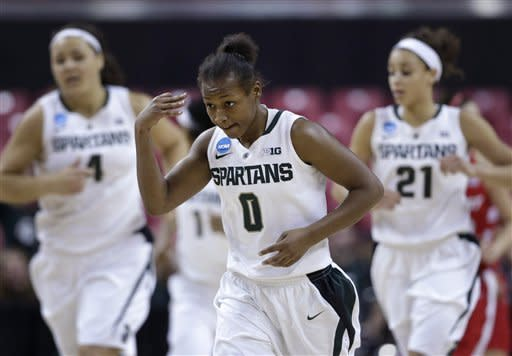 Michigan State guard Kiana Johnson, center, gestures after making a 3-pointer during the second half of a first-round game against Marist in the women's NCAA college basketball tournament in College Park, Md., Saturday, March 23, 2013. Johnson contributed a game-high 16 points to Michigan State's 55-47 win. (AP Photo/Patrick Semansky)