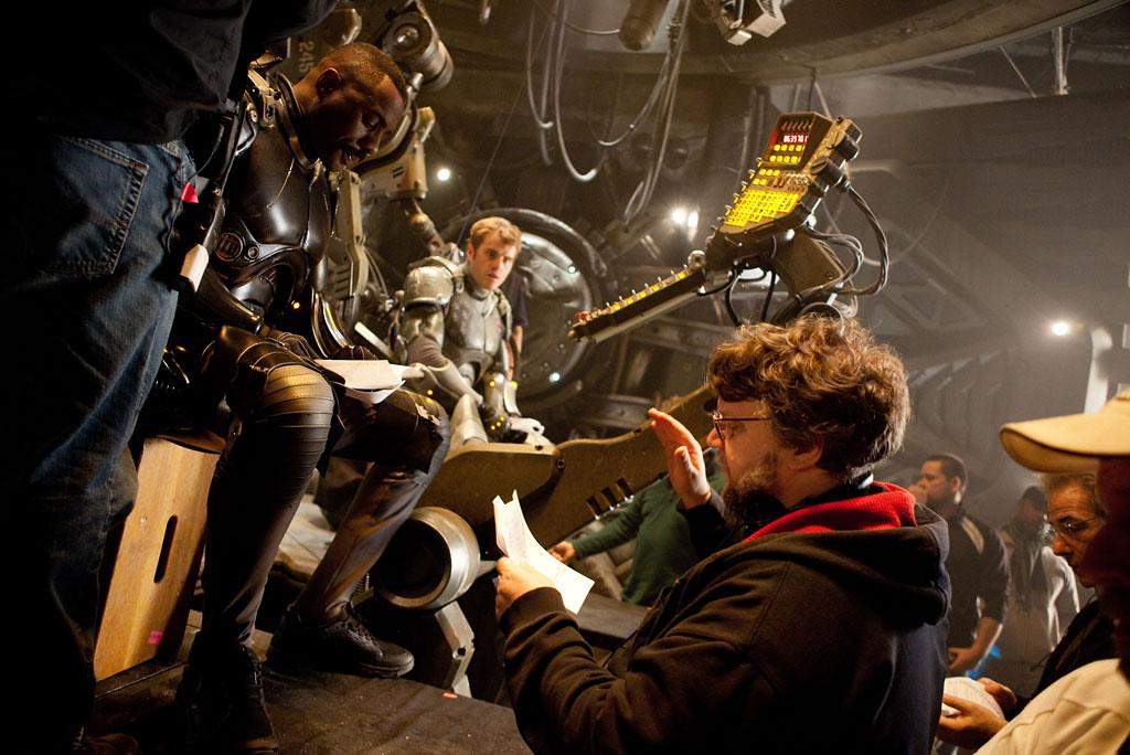 """Idris Elba, Rob Kazinsky and director Guillermo Del Toro on the set of in Warner Bros. Pictures' """"Pacific Rim"""" - 2013"""
