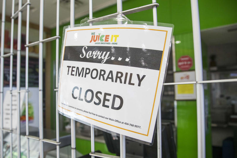 We Juice It is closed in the domestic terminal food court at Hartsfield-Jackson International Airport in Atlanta, Tuesday, April 14, 2020. (Alyssa Pointer/Atlanta Journal-Constitution via AP)
