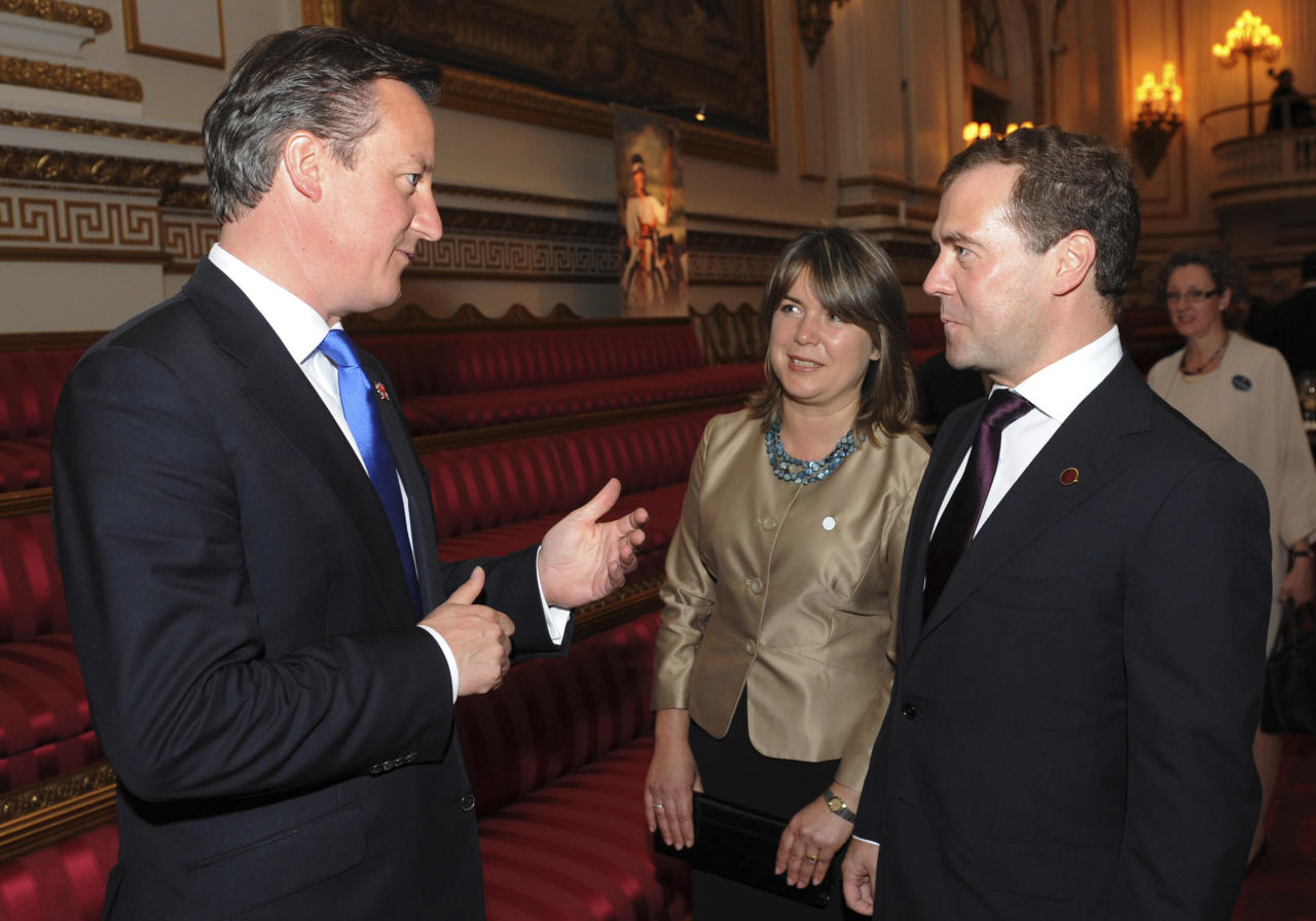 Britain's Prime Minister David Cameron, left, talks with Russian Prime Minister Dmitry Medvedev at Buckingham Palace in London for a reception hosted by Queen Elizabeth II for the heads of state and government prior to attending the opening ceremony of the London 2012 Olympic Games, Friday, July 27, 2012. (AP Photo/Stefan Rousseau, Pool)