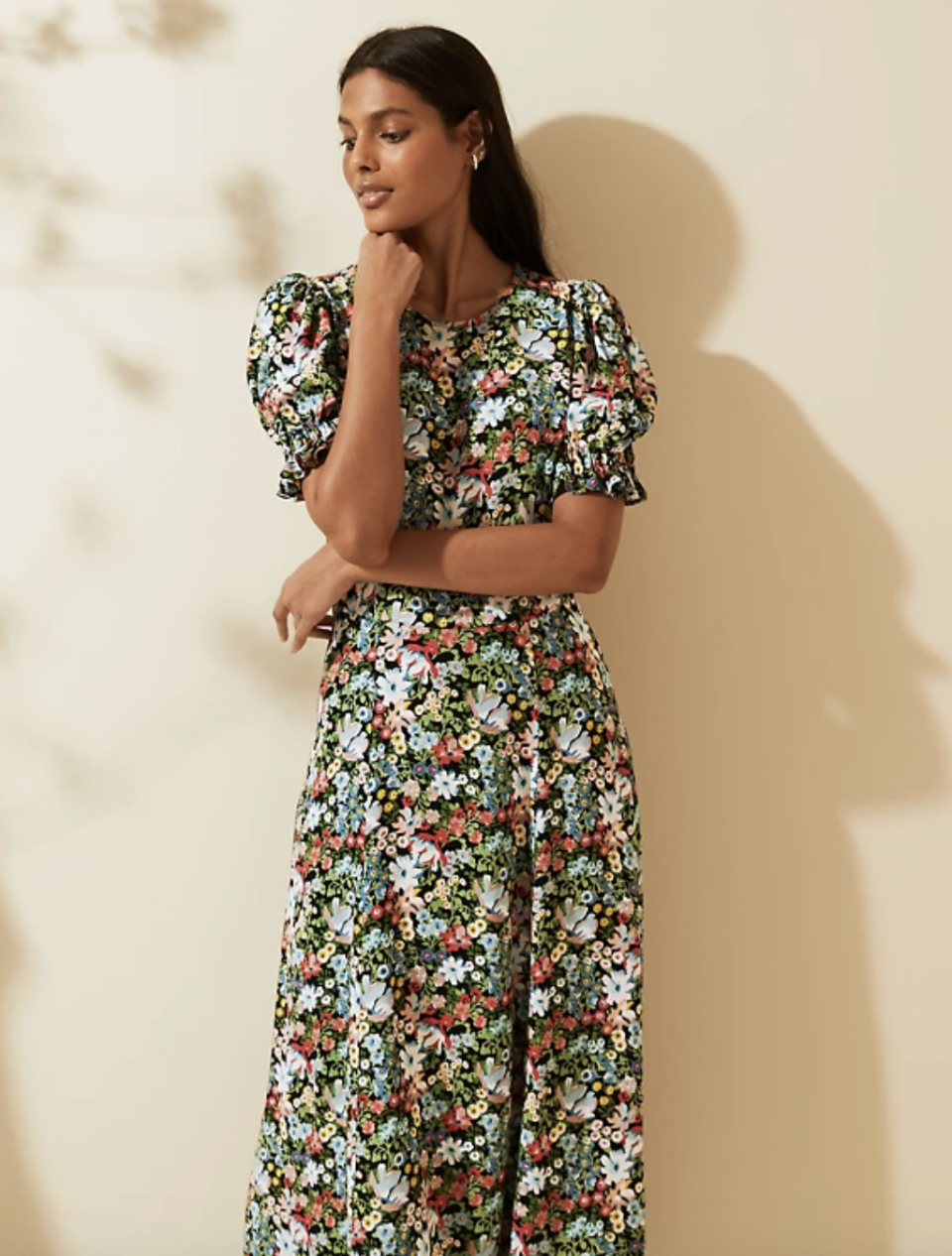 The Ghost Floral Puff Sleeve Midi Dress ticks all the boxes, and has garnered rave reviews, with some likening it to designer brands.  (Marks and Spencer)
