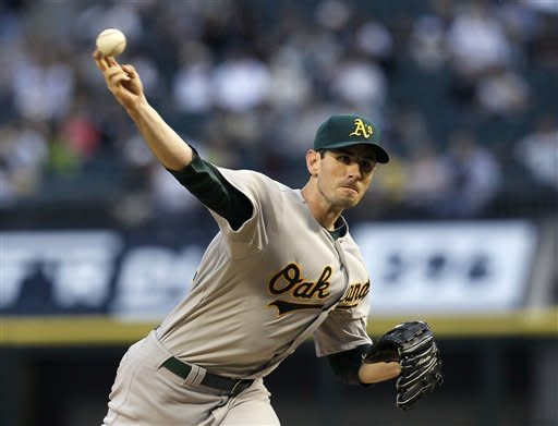 Oakland Athletics starting pitcher Brandon McCarthy delivers during the first inning of a baseball game against the Chicago White Sox on Friday, Aug. 10, 2012, in Chicago. (AP Photo/Charles Rex Arbogast)