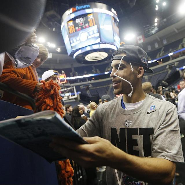 Florida guard Scottie Wilbekin walks off the court the second half in a regional final game against Dayton at the NCAA college basketball tournament, Saturday, March 29, 2014, in Memphis, Tenn. Florida won 62-52. (AP Photo/John Bazemore)