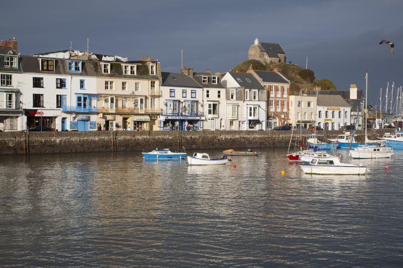 View of boats in the harbour in sunshine of winter afternoon, Ilfracombe, north Devon, England (Photo by: Education Images/Universal Images Group via Getty Images)