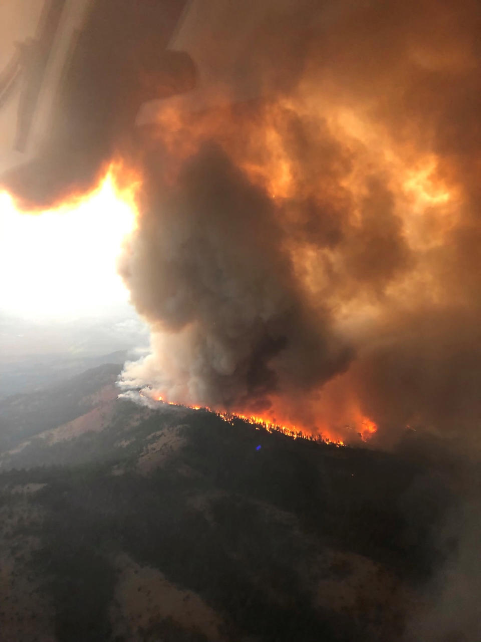 This Saturday, Sept. 4, 2021, aerial photo provided by the U.S. Forest Service Lassen National Forest shows the Great Basin Team 1 Air Attack operations on Saturday on the Dixie Fire on the Horton Ridge in Plumas County, Calif. (Great Basin Team 1 Air Attack Operations/U.S. Forest Service via AP)