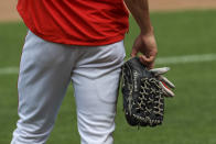 Cincinnati Reds' Shogo Akiyama holds his glove as he stands on the field during team baseball practice at Great American Ballpark in Cincinnati, Friday, July 3, 2020. (AP Photo/Aaron Doster)