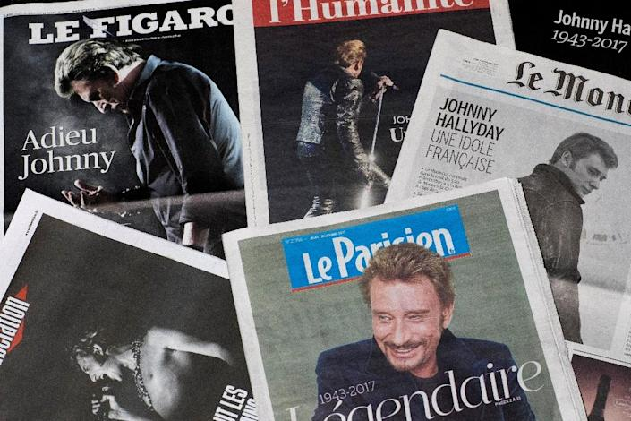 France's media have dedicated thousands of pages and hours of airtime to Johnny Hallyday (AFP Photo/JOEL SAGET)