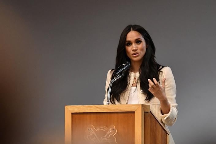 The Duchess of Sussex speaks during a school assembly as part of a visit to Robert Clack School in Essex on March 6, in support of International Women's Day. (Photo: POOL New / Reuters)