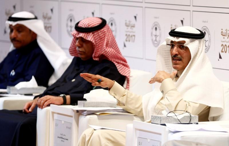 Saudi minister of finance Mohammed Al-Jadaan gestures during the 2017 budget news conference in Riyadh