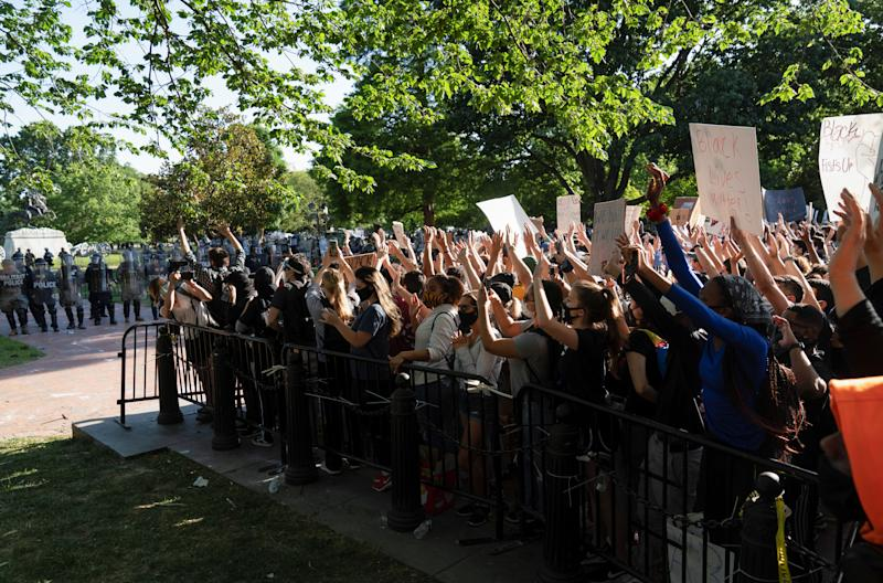 Protesters in Washington, D.C., were penned in by police before being cleared out so President Trump could walk through for a photo opportunity in front of St. John's Episcopal Church. (Ken Cedeno/Reuters)