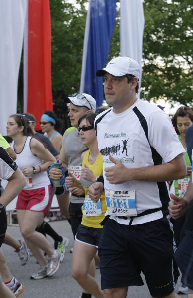 In this Sunday, May 20, 2012 photo, Congressman Tim Ryan runs in the Cleveland Marathon Sunday, May 20, 2012, in Cleveland. In what's become a daily ritual, Ryan finds a quiet spot, closes his eyes, clears his mind and tries to tap into the eternal calm. Increasingly, people in settings beyond the serene yoga studio or contemplative nature path are engaging in the practice of mindfulness, a mental technique that dwells on breathing, periods of silence and concentration to keep one's thoughts in the present moment. (AP Photo/Tony Dejak)