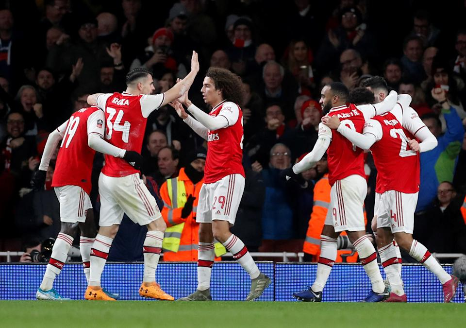 Soccer Football - FA Cup - Third Round - Arsenal v Leeds United - Emirates Stadium, London, Britain - January 6, 2020   Arsenal's Reiss Nelson celebrates scoring their first goal with teammates    Action Images via Reuters/Matthew Childs