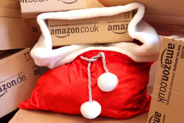 Christmas Shopping Online - Amazon boxes in Red Santa's Sack