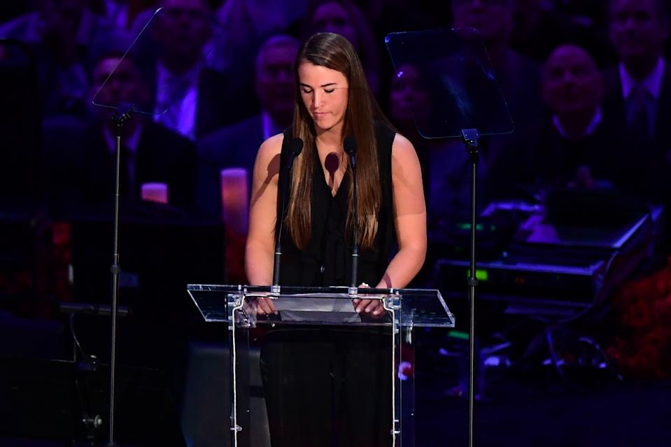 "US college basketball player Sabrina Ionescu speaks during the ""Celebration of Life for Kobe and Gianna Bryant"" service at Staples Center in Downtown Los Angeles on February 24, 2020. - Kobe Bryant, 41, and 13-year-old Gianna were among nine people killed in a helicopter crash in the rugged hills west of Los Angeles on January 26. (Photo by Frederic J. BROWN / AFP) (Photo by FREDERIC J. BROWN/AFP via Getty Images)"