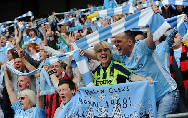 Manchester City's supporters celebrate after their team's 3-2 victory over Queens Park Rangers in the English Premier League football match between Manchester City and Queens Park Rangers at The Etihad stadium in Manchester, north-west England on May 13, 2012. Manchester City won the game 3-2 to secure their first title since 1968. This is the first time that the Premier league title has been decided on goal-difference, Manchester City and Manchester United both finishing on 89 points. AFP PHOTO/PAUL ELLIS RESTRICTED TO EDITORIAL USE. No use with unauthorized audio, video, data, fixture lists, club/league logos or 'live' services. Online in-match use limited to 45 images, no video emulation. No use in betting, games or single club/league/player publications.PAUL ELLIS/AFP/GettyImages
