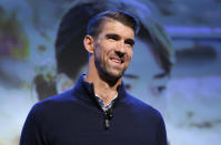 FILE - In this Jan. 6, 2020, file photo, Michael Phelps speaks during a Panasonic news conference before the CES tech show in Las Vegas. It is June 2021 in an Olympic year, and Phelps is feeling it. In his mind and in his body. Except the winningest Olympian of all time has been retired for five years. (AP Photo/John Locher, File)